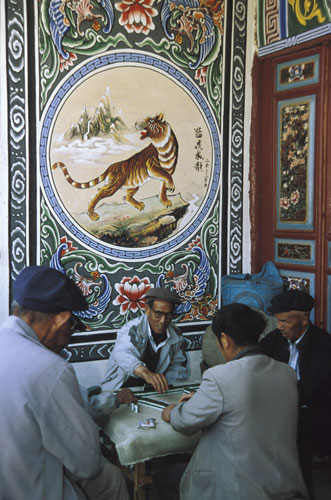Men playing Mahjong
